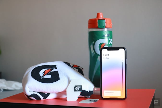 Gatorade Gx Sweat patch on a desk with Gatorade towel, bottle and an iPhone in the background