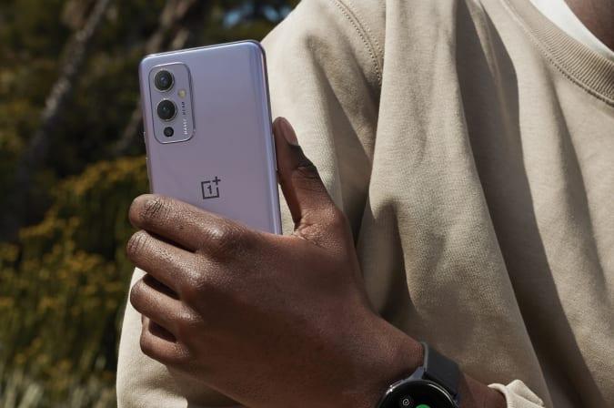 OnePlus 9 smartphone held in hand.