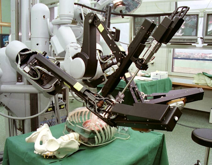 The pictures show three surgical robotic arms at work in a worldwide operating theater during a presentation for the media in the Leipzig Heart Center on February 22nd.  One of the arms contains a miniature camera, the other two hold standard surgical instruments.  The surgeon observes a monitor with a picture of the heart and manipulates the robotic arms with two handles.  The software translates large natural movements into precise micro-movements in the surgical instruments.
