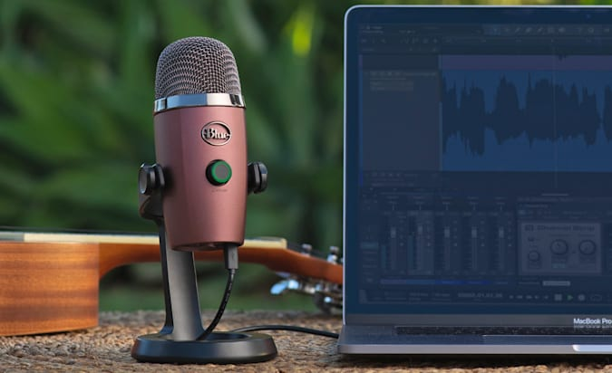 A Blue Yeti Nano microphone sitting outside next to a laptop.