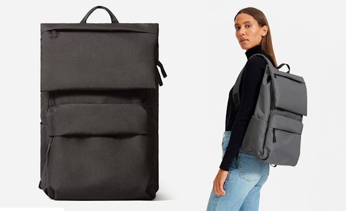 The Everlane Renew Transit backpack worn on one shoulder by a female model.