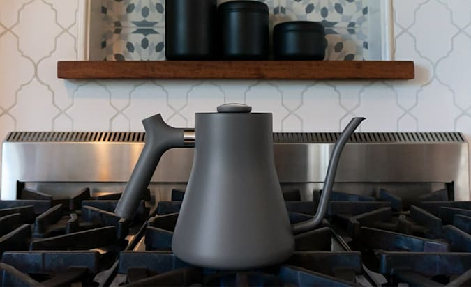 The Stagg pour-over kettle seen on a stove top.