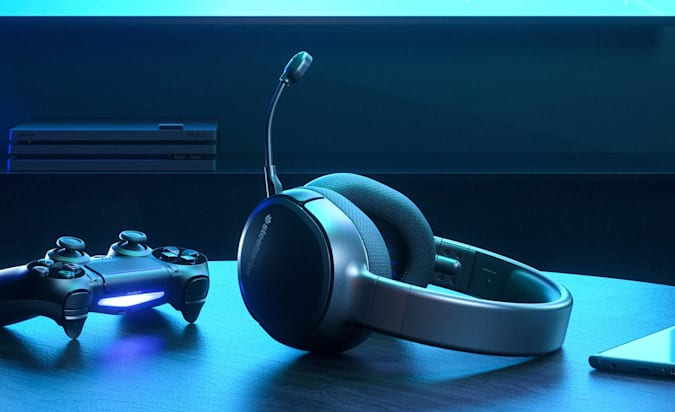 IronSeries Arctis 1 Headphones play wireless on the wash and blue table from the window.