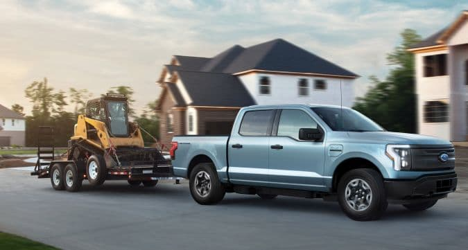 2022 Ford F-150 Lightning Pro. Pre-production model with available features shown. Available starting spring 2022. Max towing varies based on cargo, vehicle configuration, accessories and number of passengers.
