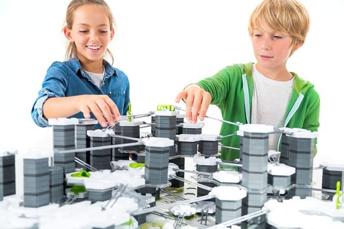 Ravensburger GraviTrax XXL Starter Set with two kids