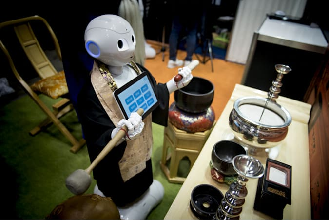 Pepper human-shaped robot while celebrating the Buddhist funeral rites to the Tokyo Int'l Funeral & Cemetery Show in Tokyo August 23, 2017. Hundreds of funeral home operators, cemeteries operators, crematorium operators, traders, suppliers, buyers, professional associations and investors gather at this professional funeral event in Japan. (Photo by Alessandro Di Ciommo/NurPhoto via Getty Images)