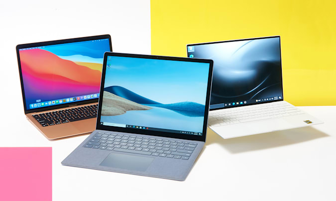 Three laptops against a bright colorful background.