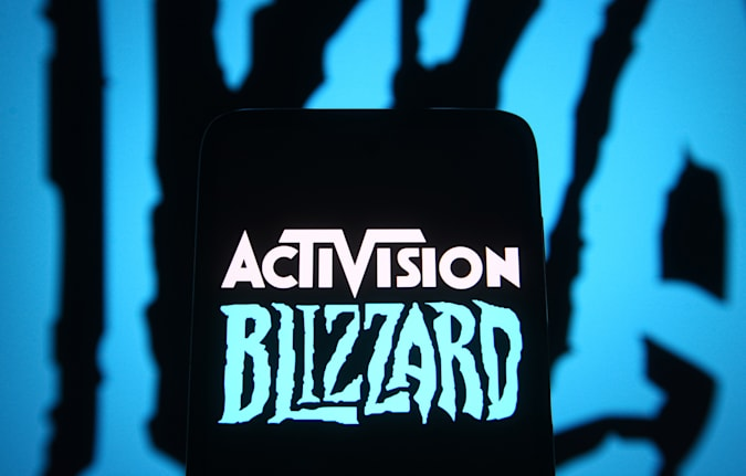 UKRAINE - 06/18/18: In this photo illustration, the Activision Blizzard logo of the video game company is seen on the smartphone screen in front of the Blizzard Entertainment logo.  (Photo illustration by Pavlo Gonchar / SOPA Images / LightRocket via Getty Images)