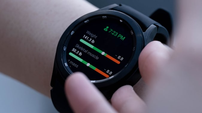 Body composition measurement results on the screen of a black Samsung Galaxy Watch 4