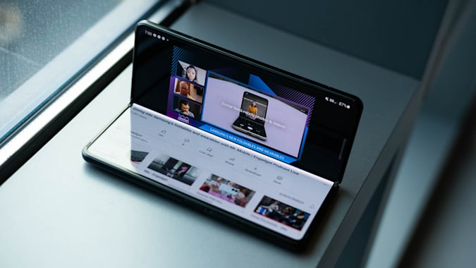 Watching a video with the Samsung Galaxy Z Fold 3 half bent and sitting up on a window ledge like a mini laptop.