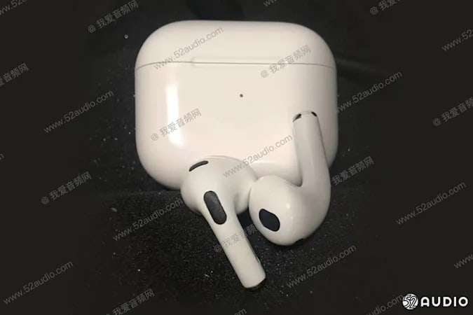 Two white wireless earbuds on top of a white charging case. Image is covered with a translucent watermark with Chinese characters and the url