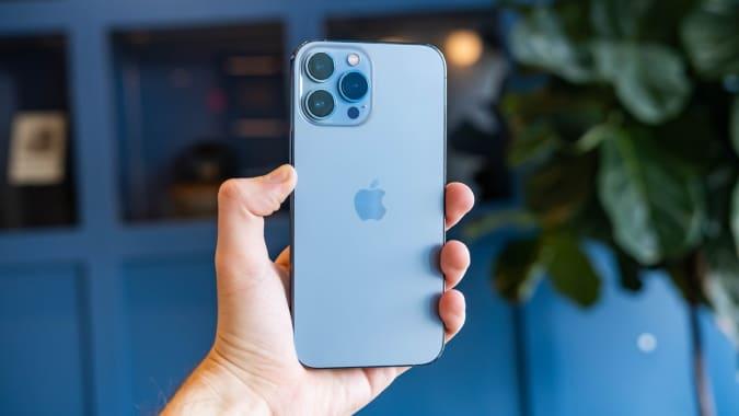 An iPhone 13 Pro Max in Sierra Blue