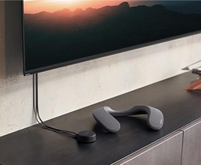 Alto-falante com banda de pescoço sem fio Sony SRS-NS7 e transmissor WLA-NS7.