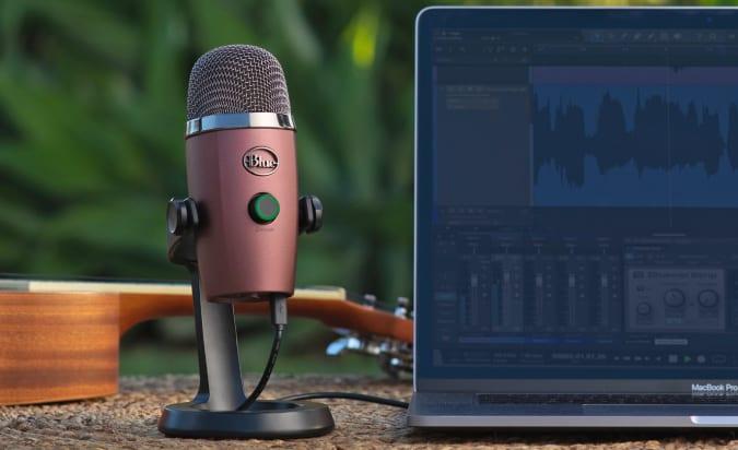 A Blue Yeti Nano microphone sitting outside next to a laptop.