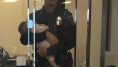 'Hero' Cop Robert Lofgran Holds Mom's Baby While She Files Domestic Violence