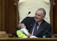 New Zealand Parliament Speaker Trevor Mallard Holds Baby For MP Dad During