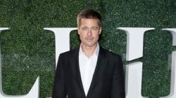 Brad Pitt aminci sur le tapis rouge avec Marion