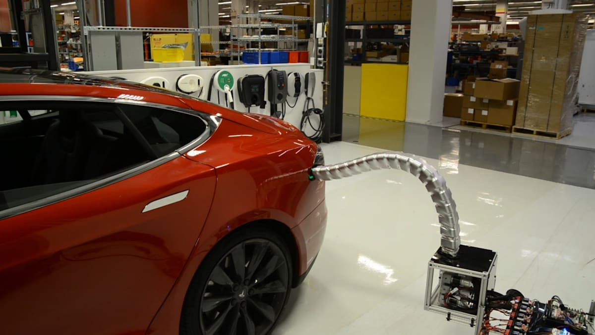 Keep Your Flying Cars And Robot Maids We Are Already Living In Elon Musk S Future Tesla Officially Unveiled Its Automatic Charging System Today