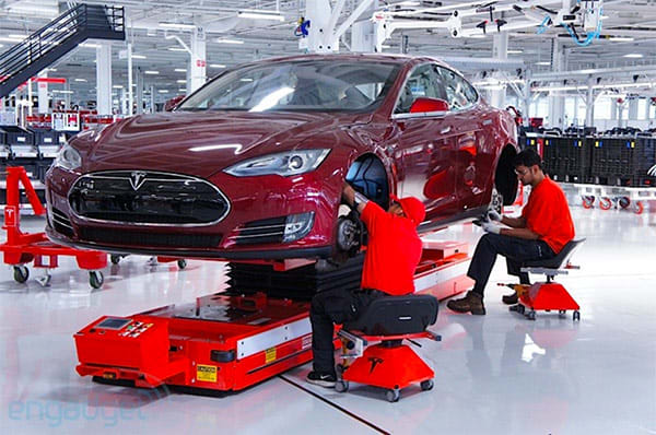 Tesla behind on Model S production goals, aims for extra cash with