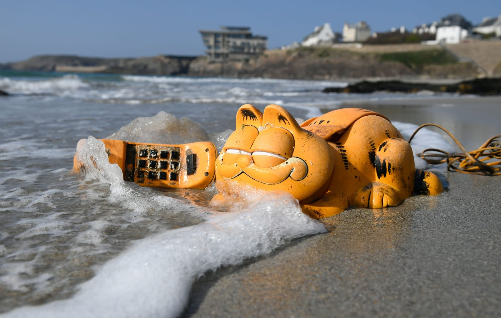 5ad28c723c Why Garfield phones have littered French beaches for 35 years