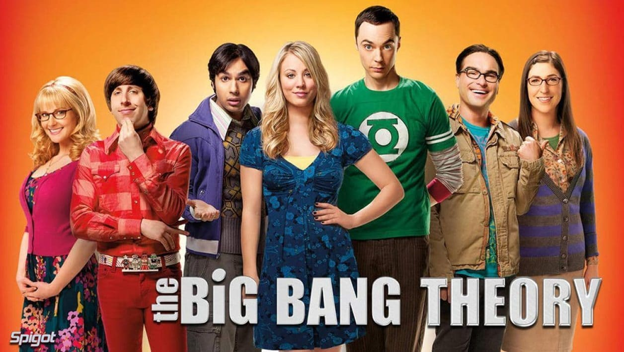 The cast of The Big Bang Theory posing on an orange background
