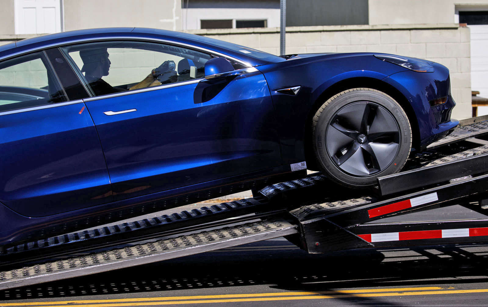 Tesla allegedly 'gutted' Model 3 delivery team with recent job cuts