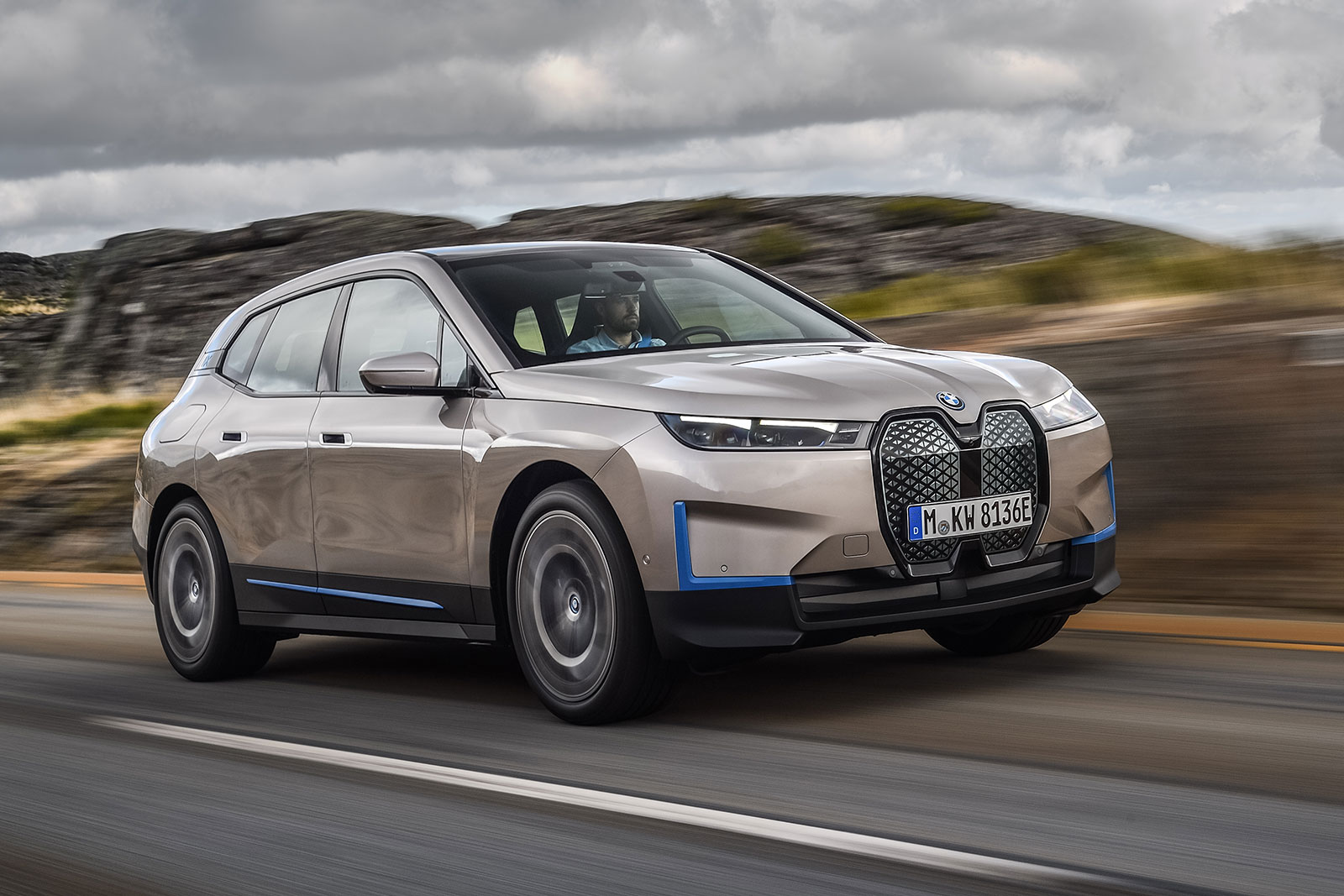 BMW's iX is a flagship electric SUV with 300 miles of ...