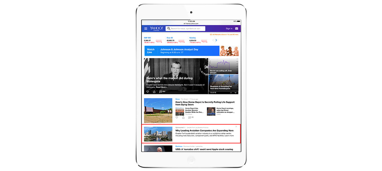 A tablet shows an ad placement