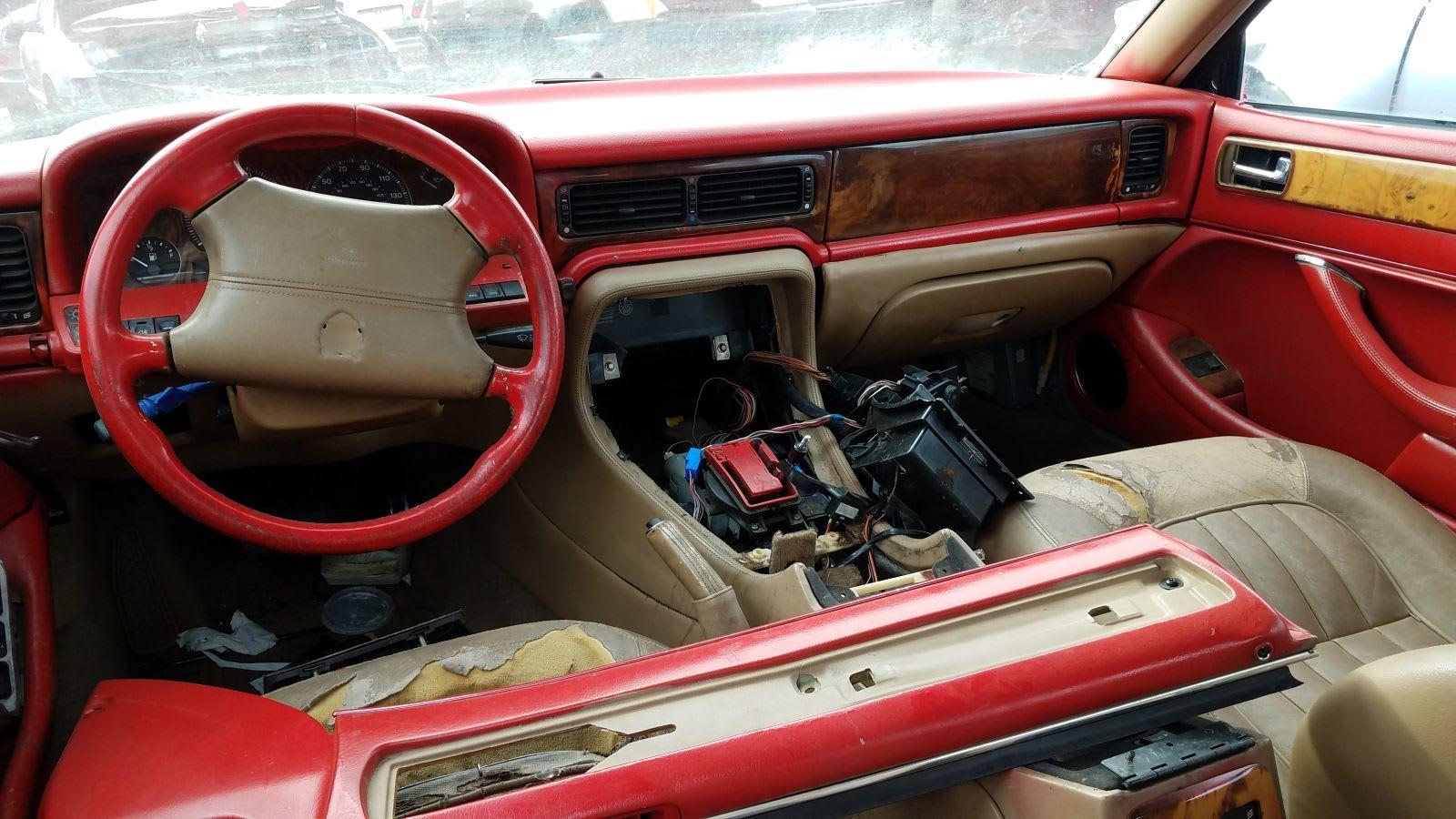 Junked 1996 Jaguar XJ6 and 1999 Mercedes-Benz E320