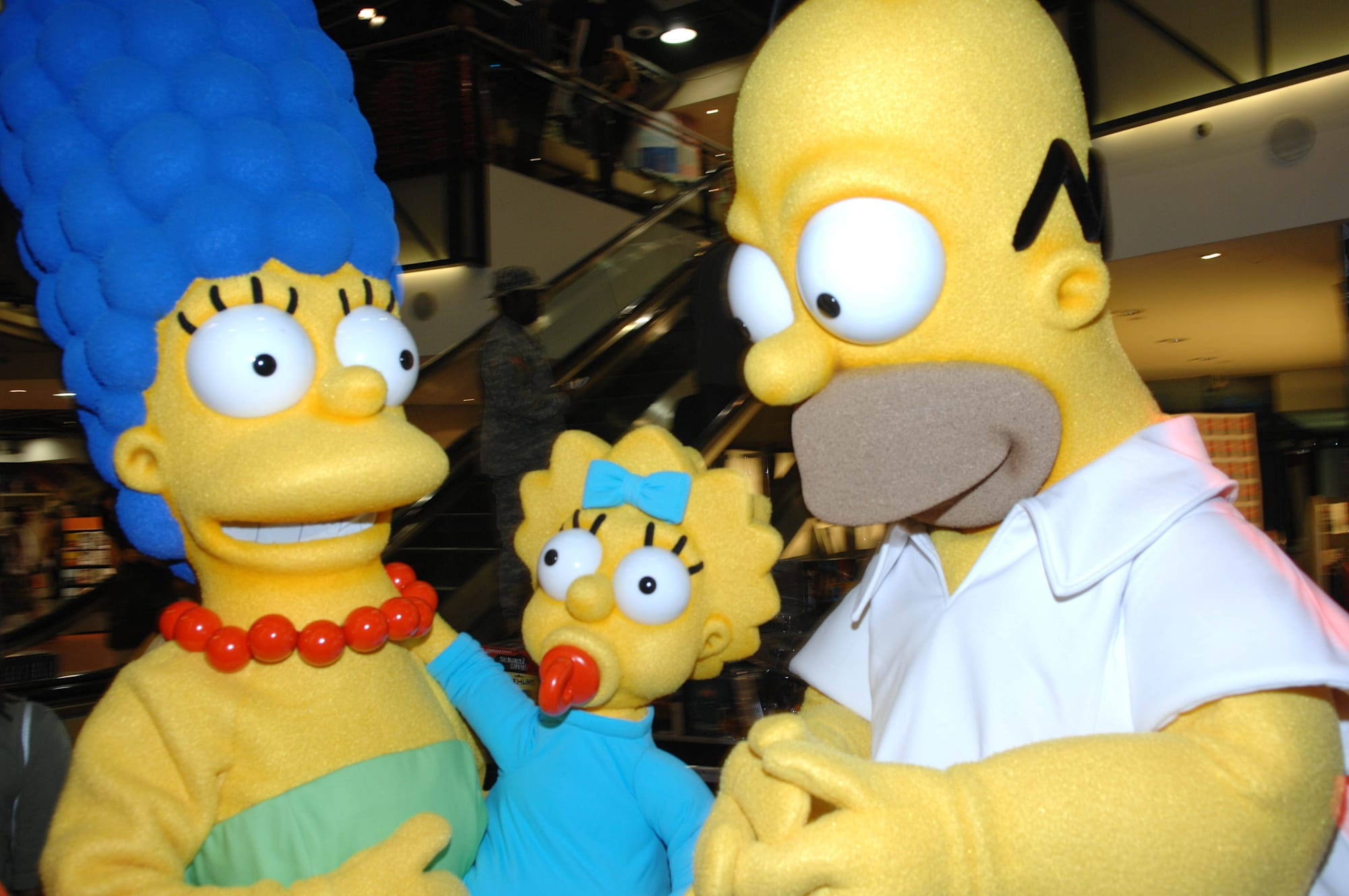 """Costumed Characters From """"The Simpsons"""" Stop By Virgin Megastore"""