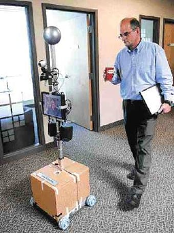 Man telecommutes by sending in a robot replacement