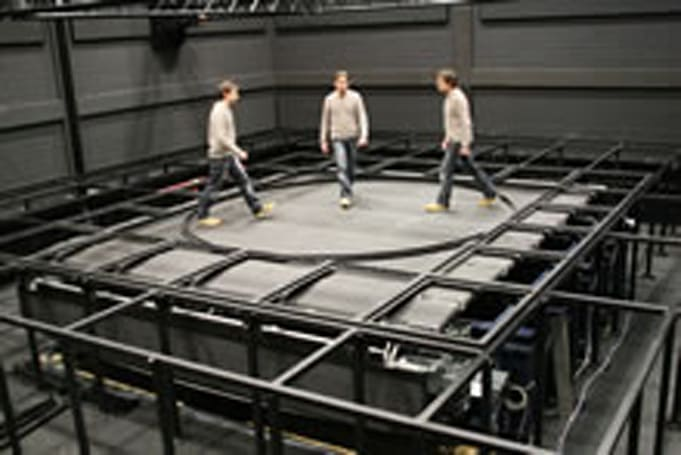 Omni-directional treadmill allows individuals to sashay through virtual cities