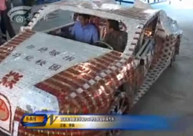 Chinese university students build KIRF Bugatti Veyron all-electric vehicle from discarded cigarette packs (video)