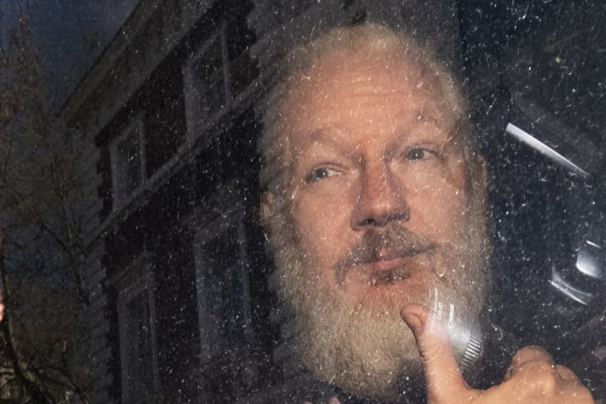 Julian Assange sentenced to 50 weeks in prison for skipping bail