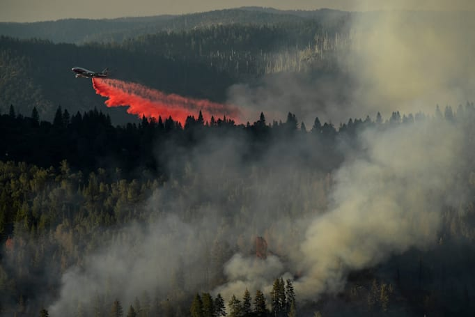 A 747 'Supertanker' rains retardant on California's wildfires