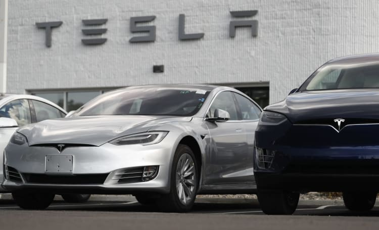 Tesla raises prices, cuts options to simplify its EV lineup (updated)