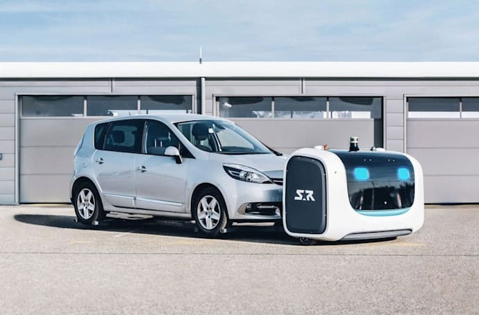 Robot valets are parking cars at an airport in France