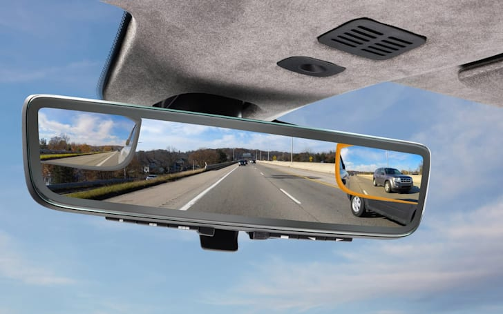 Aston Martin's rearview mirror shows three video feeds simultaneously