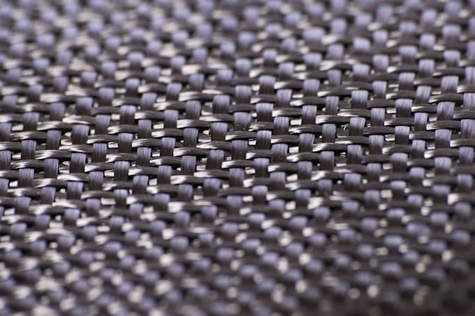 Chaos leads to stronger carbon fiber