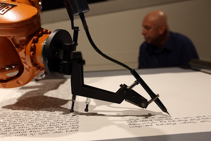 ​The Big Picture: A Robot writing the Torah in longhand