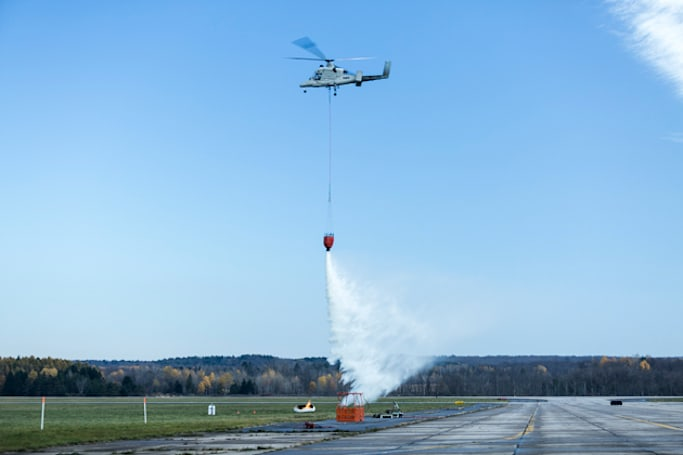 Watch an unmanned helicopter put out fires with help from a drone