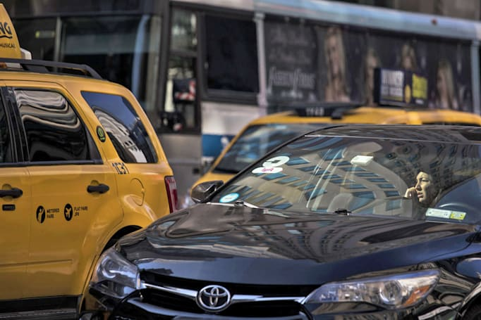NYC mayor signs ride-hailing vehicle cap into law