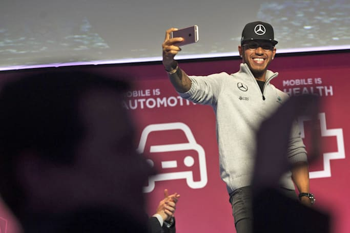 F1 champion Lewis Hamilton isn't afraid of self-driving cars