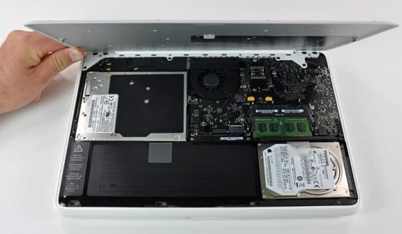 10-hour MacBook delicately disassembled, battery transplanted into earlier model