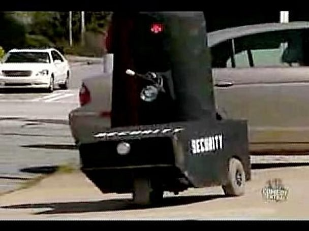 Homemade security 'bum bot' turns up on the Colbert Report
