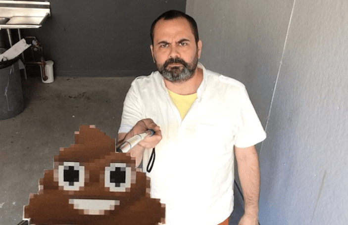 Artist adds poop emoji to selfie sticks to remind us of mortality