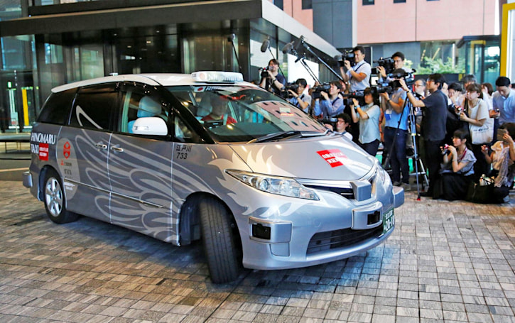 The race for self-driving taxis at the 2020 Olympics is heating up