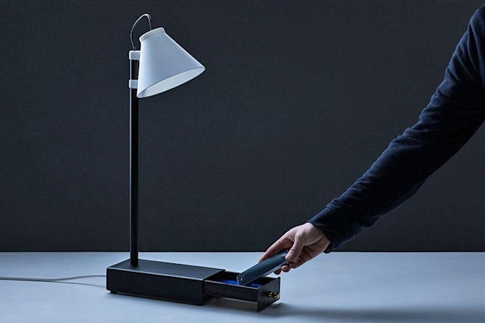 This lamp turns on by holding your smartphone hostage