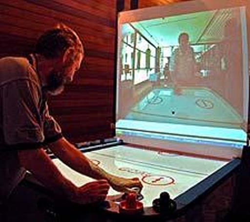 Airhockey Over a Distance