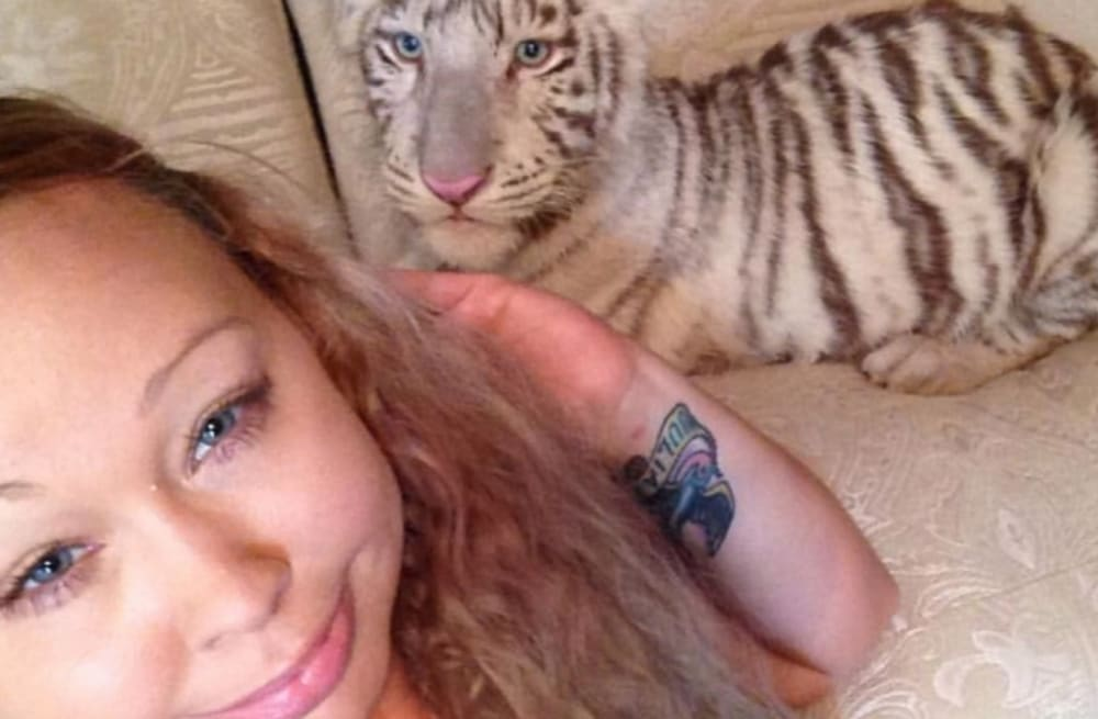 Mom arrested after cops find 4 tigers, cougar, fox and sunk